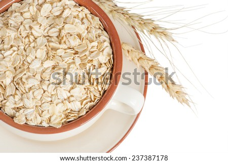 Oatmeal in a ceramic bowl on a white background - stock photo
