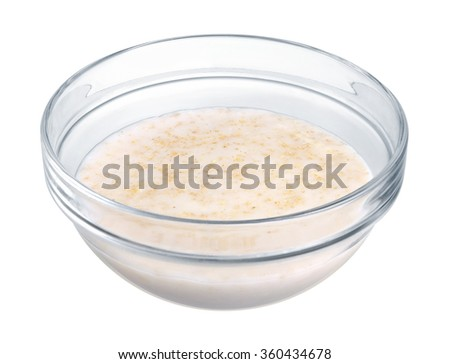 Oatmeal in a glass bowl on white background - stock photo