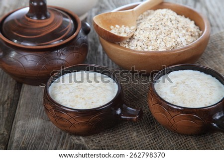 Oatmeal on old wooden table. Delicious breakfast. - stock photo