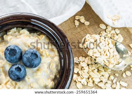 Oatmeal porridge with fresh berries - stock photo