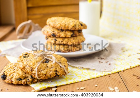 Oatmeal raisin cookie tower  with flax and sesame seeds and  bottle of milk on the background - stock photo