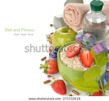 Oatmeal, strawberries and measuring tape on a white background - stock photo