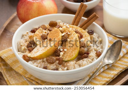 oatmeal with apples, raisins and cinnamon, top view, close-up, horizontal - stock photo