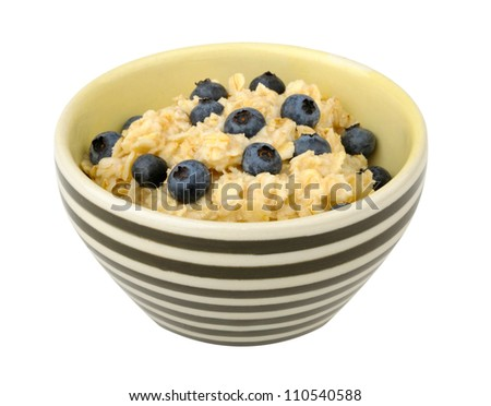 Oatmeal with blueberries in a bowl isolated on white background - stock photo