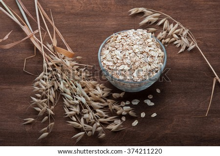 oatmeal with ears of oats - stock photo