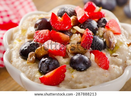 Oatmeal with fresh Berries and nuts  for a Healthy Breakfast. Selective Focus
