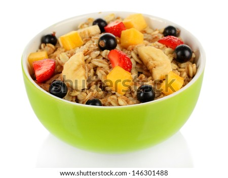 Oatmeal with fruits isolated on white - stock photo