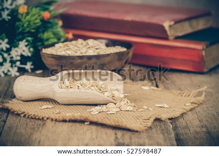 oats in spoon on wood table with vintage tone