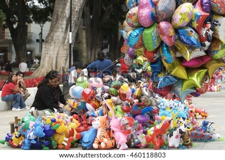 Oaxaca, Mexico-December 26, 2008: A woman sells balloons in the square