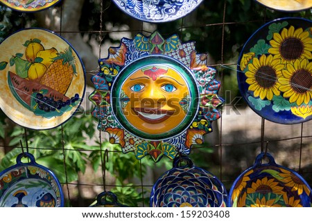 OAXACA, MEXICO - JUL 23: Multi-colored souvenirs and national craft in Oaxaca, Mexico, 23 July 2012. The city architecture of Oaxaca is protected by UNESCO - stock photo
