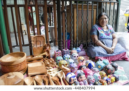 OAXACA MEXICO- MARCH 21, 2016: Woman posing with typical handicraft in a market in Oaxaca, Mexico - stock photo