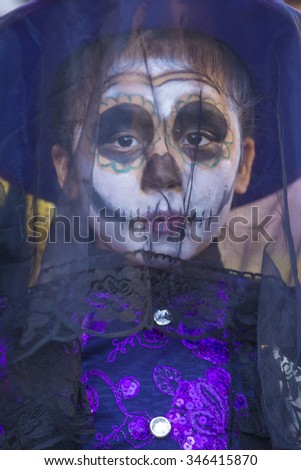 OAXACA , MEXICO  - NOV 02 : Unknown participant on a carnival of the Day of the Dead in Oaxaca, Mexico, on November 02 2015. The Day of the Dead is one of the most popular holidays in Mexico