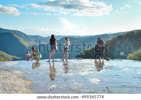 Oaxaca, Mexico - November 15, 2014: Young people pose for photos and chill in the pools of the Hierve el agua hot springs  in the state of Oaxaca, Mexico