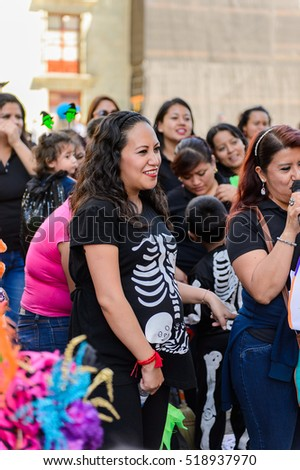 OAXACA, MEXICO - OCT 31, 2016: Unidentified people dressed and painted for the Day of the Dead (Dia de los Muertos), national Mexican holiday, UNESCO Intangible Cultural Heritage of Humanity