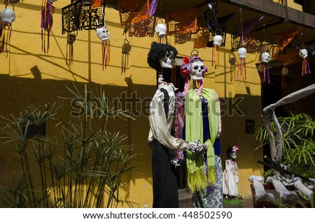 OAXACA, OAXACA, MEXICO- NOVEMBER 2, 2015: Skeleton couple dressed with traditional mexican clothes. Part of the day of the dead celebration in Oaxaca, Mexico - stock photo