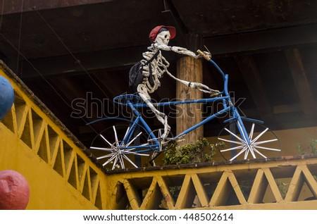 OAXACA, OAXACA, MEXICO- NOVEMBER 2, 2015: Skeleton kid riding a bicycle. Part of the day of the dead celebration in Oaxaca, Mexico - stock photo