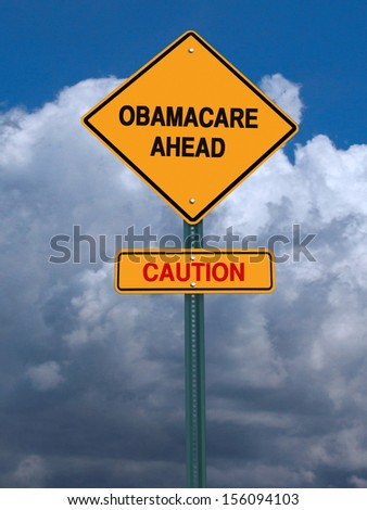 obamacare ahead caution conceptual directional post over dramatic blue sky
