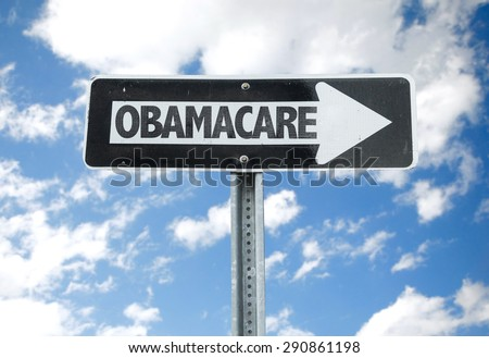 Obamacare direction sign with sky background - stock photo