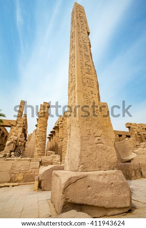 Obelisk and row of pillars inside the Temple of Karnak. Luxor, Egypt,  Africa - stock photo