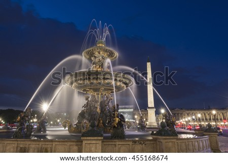Obelisk of Luxor and fountain with water motion  at the Place de la Concorde in Paris at night - stock photo