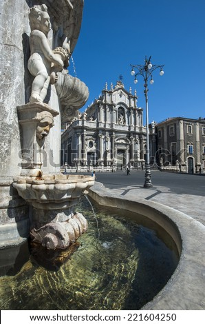 obelisk of the fountain of the elephant and the cathedral of Santa Agata in square of the Duomo, Catania, Sicily, Italy - stock photo