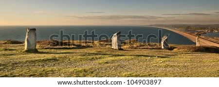 Obelisks' Sea View;  Four Obelisks' stand sentinel over the chesil atop the quarried cliffs of Portland.