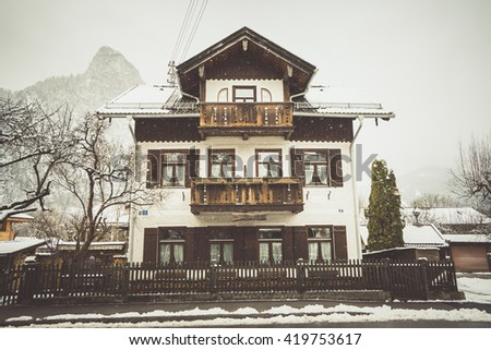OBERAMMERGAU, GERMANY -  MARCH 07: View on beautiful decorated house facade with ornamental balcony and windows on March 07, 2016 in Oberammergau, Germany.