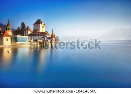 Oberhofen castle on the lake Thun, Switzerland - stock photo