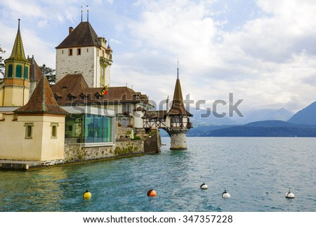 OBERHOFEN, SWITZERLAND - SEPTEMBER 08, 2015: Castle of Oberhofen dates back history to the 13th century. Branch museum of the Historic Museum of Berne opened to the public since 1954