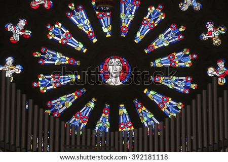 OBERSTAUFEN, GERMANY - OCTOBER 20: Jesus, stained glass window in the parish church of St. Peter and Paul in Oberstaufen, Germany on October 20, 2014. - stock photo
