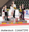 OBERSTDORF - SEPT 29: Ice dance winners Madison Chock and Evan Bates of the USA on the podium, with other medalists, during Nebelhorn Trophy medal ceremony on September 29, 2012 in Oberstdorf, Germany - stock photo