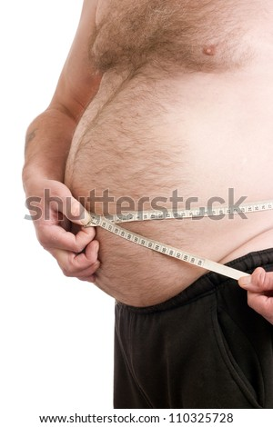 Obese male with measuring tape around stomach - stock photo