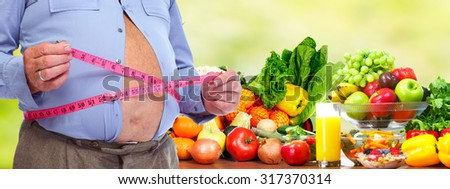 Obese man abdomen. Obesity and weight loss. - stock photo