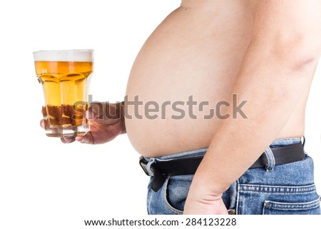 Obese man with big belly holding a glass of refreshing cold beer - stock photo