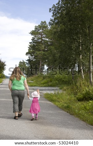 Obese mother and child walking on a forest path on a beautiful summer day. - stock photo
