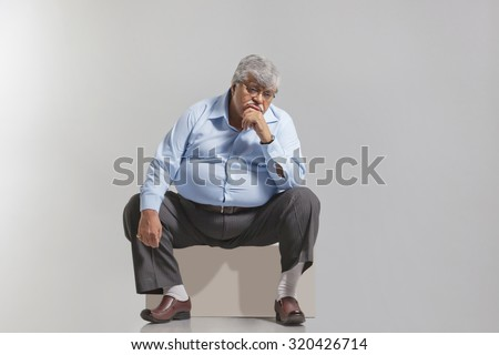 Obese old man feeling sad - stock photo