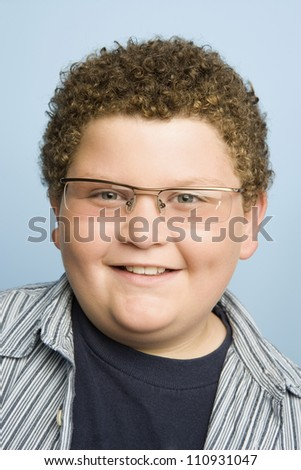 Obese teenage boy isolated over blue background