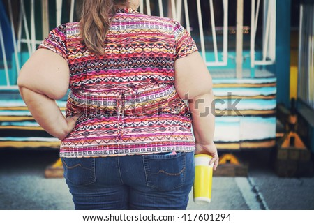 Obese woman at a carnival - stock photo