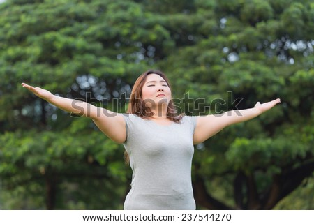 Obese woman breath of fresh air. - stock photo