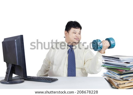 Obesity businessman working while workout. isolated on white background