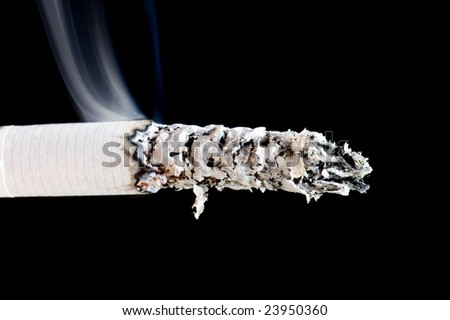 object on black - cigarette with smoke - stock photo