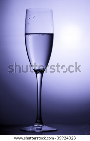 object on blue - champagne glasses close up