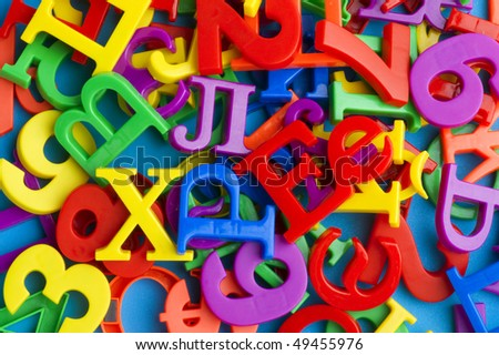 object on blue - toy plastic letters and numbers