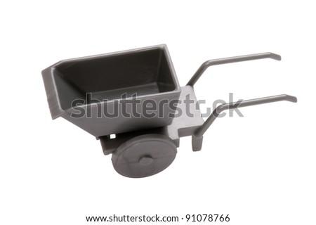 object on white - Toy wheelbarrow close up - stock photo