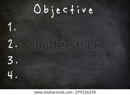 Objective list on blackboard - stock photo