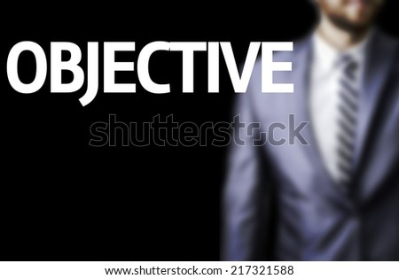 Objective written on a board with a business man on background - stock photo