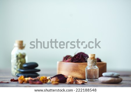 Objects for aromatherapy with focus on vial - stock photo