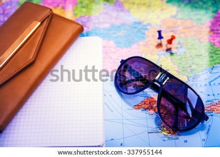 objects for travel isolated on a map background - stock photo