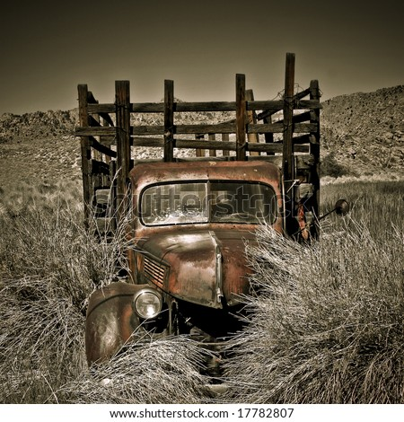 Objects in various stages of decay and aging, abandoned and forgotten - truck - stock photo