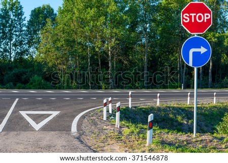 obligatory stop sign at an intersection on a country road - stock photo